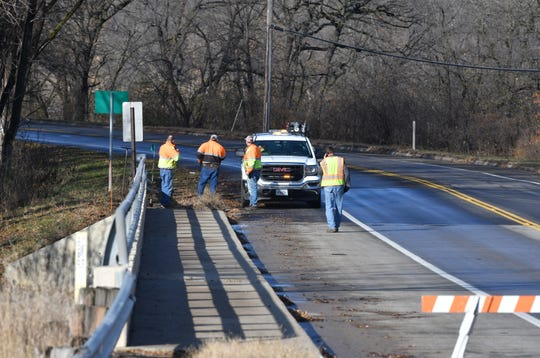 Crews works to fix a broken main along Stearns County Road 1 in Sartell on Tuesday, Nov. 19, 2019.