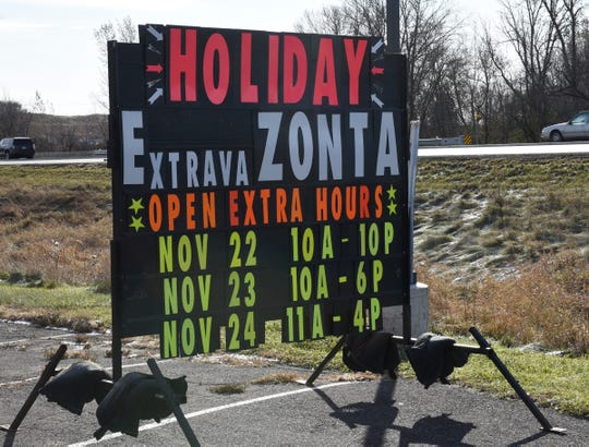 A sign for the Zonta Christmas House is displayed outside of Modern Barnyard on County Road 75 Tuesday, Nov. 12, 2019.
