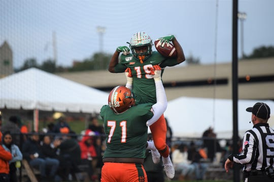 FAMU offensive lineman Tyrell Reed lifts wide receiver Xavier Smith in celebration of his touchdown in the 39-7 victory over Howard on Nov. 16, 2019 at Bragg Memorial Stadium.