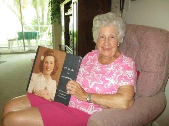 Toni enjoying special memories at her 90th birthday celebration.