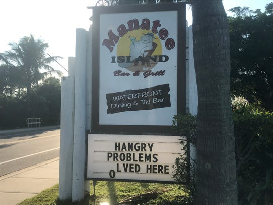 Sign outside Manatee Island Bar & Grill restaurant, 1640 Seaway Drive Fort Pierce.