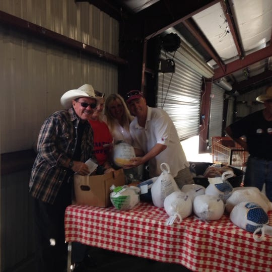 Jesse Zermeno, president of Operation Hope in Fellsmere,  and his volunteers get ready to distribute turkeys at the 2016 Operation Hope turkey giveaway.