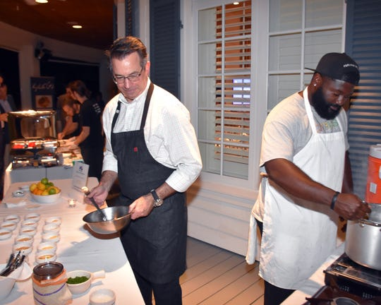 Executive Chef Scott Varricchio, left, of Citrus, prepares samplings of his Signature Dish at the 2018 Signature Chefs Auction benefiting the March of Dimes.