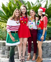 Christine Nisa Mulrooney, left, and daughters Maria, Kristina and Lauren are all decked out for the Holiday Home Tour on Dec. 8 in Stuart.