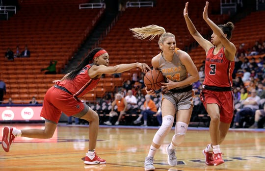 UNM's Antonia Anderson, left, goes for the strip against UTEP's Katarian Zec who drives to the basket against UNM's Ahlise Hurst, right.