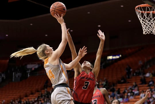 UTEP's Katarina Zec shoots over UNM's Ahlise Hurst during their game Tuesday at the Don Haskins Center.