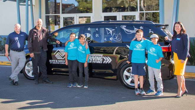 Welcoming the new van to the Boys & Girls Clubs of Greater Conejo Valley are, left, Bridgestone representatives, Kevin Brumfield and Kenny Brown joined by club members Moises Robledo, Josue Agustiniano, Chase Zirwes and Jonathan Robledo.  On right is Crystal Nāone, president/CEO of the youth organization.