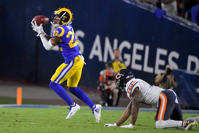 St. Bonaventure High graduate Troy Hill intercepts a pass intended for Bears wide receiver Anthony Miller during the first half of the Rams' win Sunday at the Coliseum.