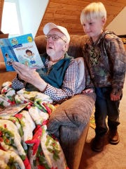 Tony Dantzman reads to his great-grandson, Jess Alan Bigham.