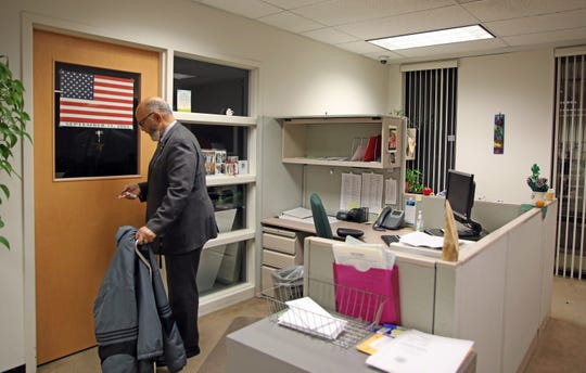 Ramapo Town Clerk Christian Sampson, a former East Ramapo School Board member, is retiring after more than 20 years, with the Town Board. Sampson locks up his office after his first day back to work after having hip surgery on Nov.18, 2019.