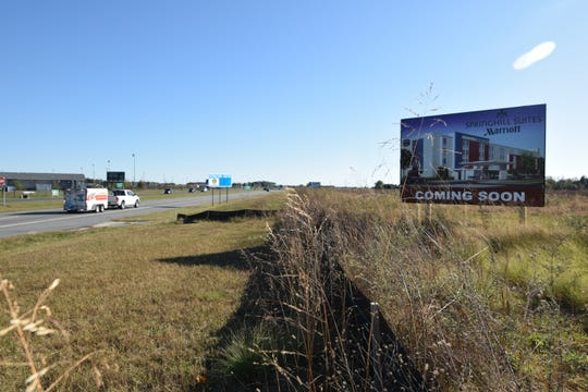An advertisement for an upcoming hotel stands across Del. 1 from DE Turf near Frederica on Nov. 1, 2019.