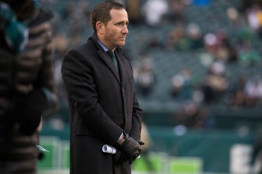 Philadelphia Eagles Executive Vice President/General Manager Howie Roseman watches as the Eagles warm up before facing the New England Patriots Sunday at Lincoln Financial Field.