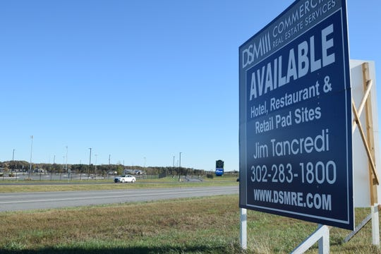 An advertisement for available restaurant, hotel and retail sites stands across Route 1 from DE Turf near Frederica on Nov. 1, 2019.