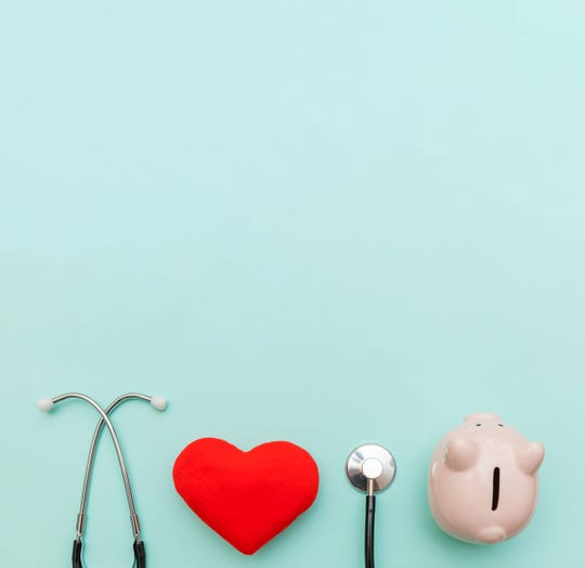 Getty Images Medicine doctor equipment stethoscope or phonendoscope piggy bank and red heart isolated on trendy pastel blue background.