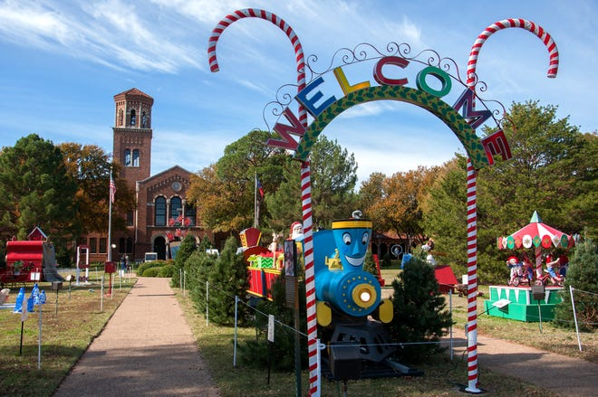 The Welcome Candy Cane sand the Little Engine that Could greet visitors to the MSU-Burns Fantasy of Lights.