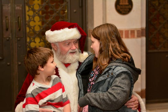 Santa visits with children at the opening of the MSU-Burns Fantasy of Lights on Monday in front of the Hardin building at MSU.