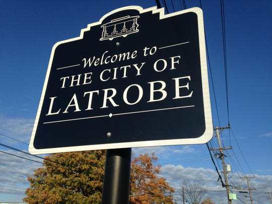 All the Latrobe city street signs are topped with trolleys.