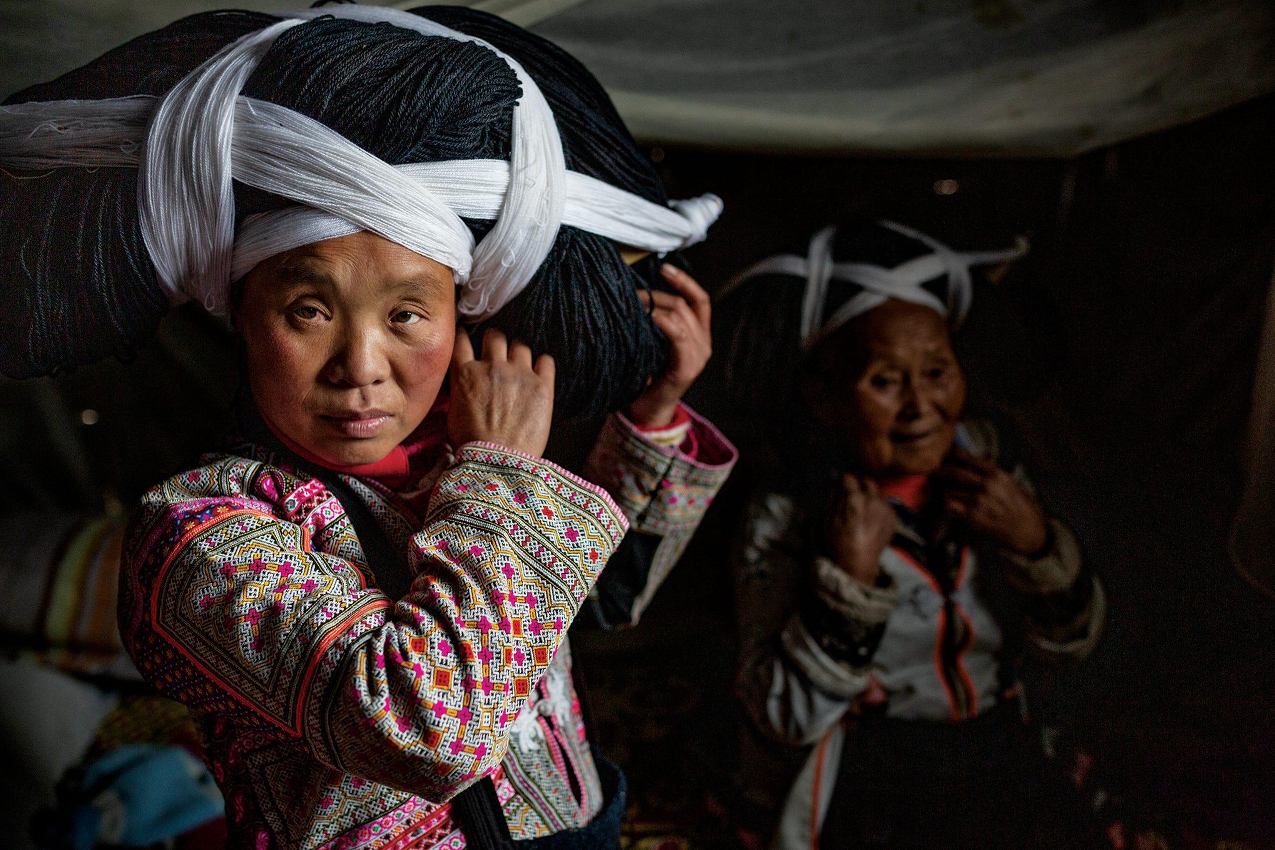 نتيجة بحث الصور عن Women of the Longhorn Miao tribe in Guizhou province, China, wear elaborate headdresses of linen and wool on special occasions.