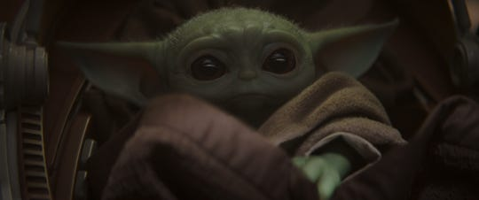 "Baby Yoda shows off his big, cute eyes on ""The Mandalorian."""