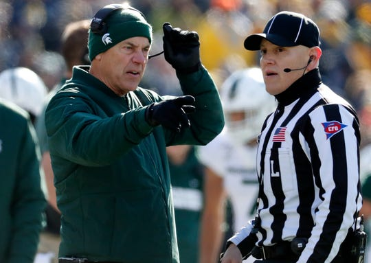 Michigan State coach Mark Dantonio talks to an official during the first half against Michigan.