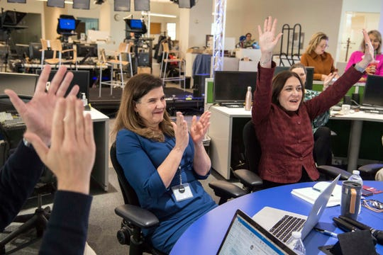 April 16, 2018; McLean, VA, USA; Nicole Carroll, Editor in Chief of USA TODAY, center, and Maribel Perez Wadsworth, President of USA TODAY Network, and Publisher of USA TODAY, right, celebrate as The Arizona Republic with the USA TODAY Network received the Pulitzer Prize for Explanatory Reporting for The Wall during a celebration in the USA TODAY newsroom following the announcement of the 2018 Pulitzer Prizes. Carroll was Editor in Chief of the Arizona Republic during coverage of The Wall.