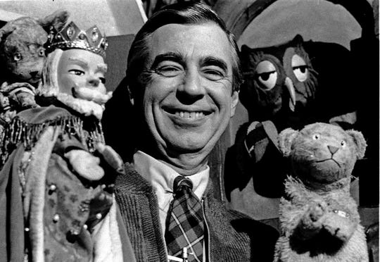 Fred Rogers poses with some of the residents of the Neighborhood of Make-Believe: King Friday (left), Daniel Striped Tiger and X the Owl in 1984.