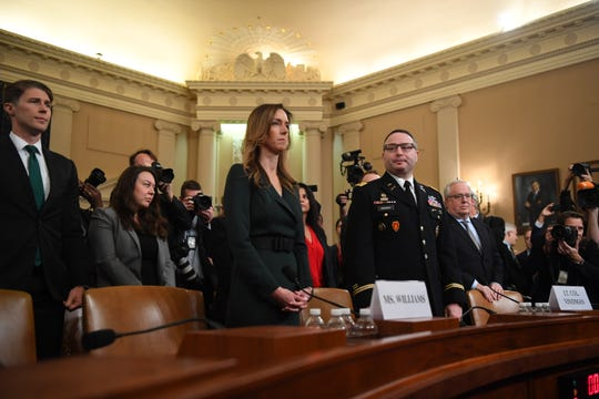 Jennifer Williams, a foreign policy aide to Vice President Mike Pence, and Army  Lt. Col. Alexander Vindman, a Ukraine expert for the National Security Council, testify on Nov. 19, 2019.