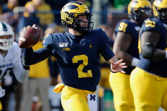 Michigan quarterback Shea Patterson passes against Michigan State Spartans.