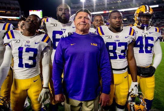 LSU players and coach Ed Orgeron stand together after beating Mississippi at Vaught-Hemingway Stadium.