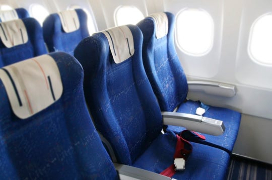 Seat rows in an airplane cabin.