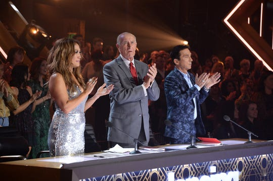 Judges Carrie Ann Inaba, left, and Bruno Tonioli, right, will be sitting adjacent to the dance floor when Season 29 of 'Dancing with the Stars' begins, but producers are trying to figure out how to include Len Goodman, center, who is in England and can't be on set because of pandemic-related travel restrictions.