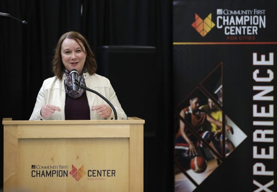 Pam Seidl, executive director of the Fox Cities Convention & Visitors Bureau, speaks during a ribbon-cutting ceremony Wednesday at the Community First Champion Center in Grand Chute.