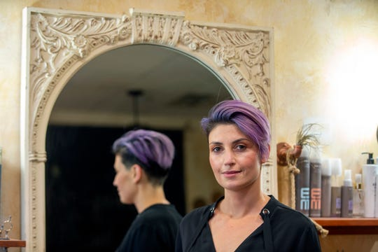 Marina Lantos, owner of Serenity Hair Lounge, talks about her business in Atlantic Highlands, NJ Wednesday, November 20.