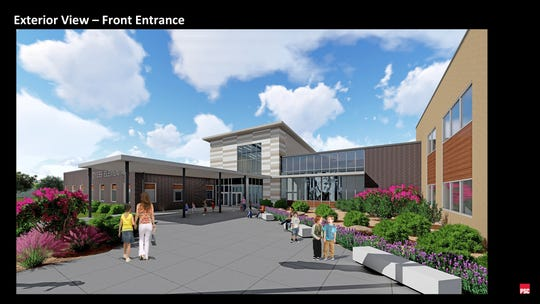 A rendering shows the main entrance to Dyess Elementary School's replacement campus, designed by architects of Parkhill Smith & Cooper. A portrait of Lt. Col. William Edwin Dyess would hang in the windows of the school, providing students access to history at the school.
