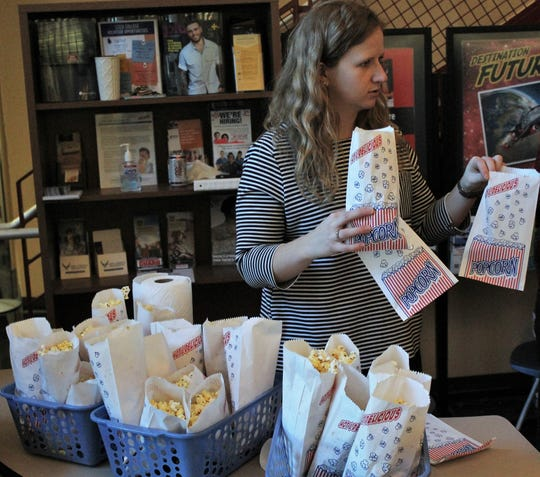 Audrey Schaffer a faculty member at the Abilene campus of Cisco College, readies bags for filling at a recent Popcorn Day. The free treat provides awareness of the Food for Thought pantry located in a room behind Schaffer. Nov. 4 2019