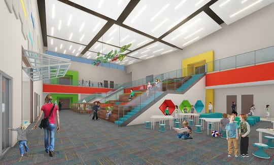 A rendering of the proposed two-story library for the replacement Dyess Elementary campus.