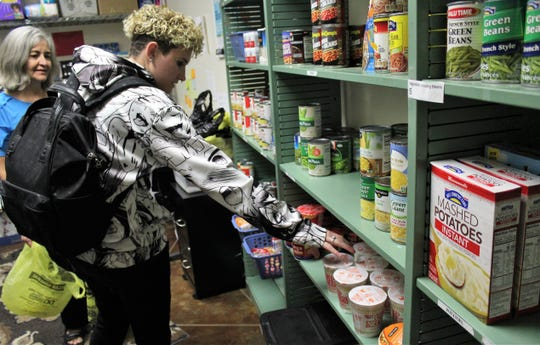Christina Ross, a student at the Abilene campus of Cisco College, selects items items at the Food for Thought pantry. Dr. Kathie Wright assisted her with what items Ross  could take on this one trip. Nov. 4 2019