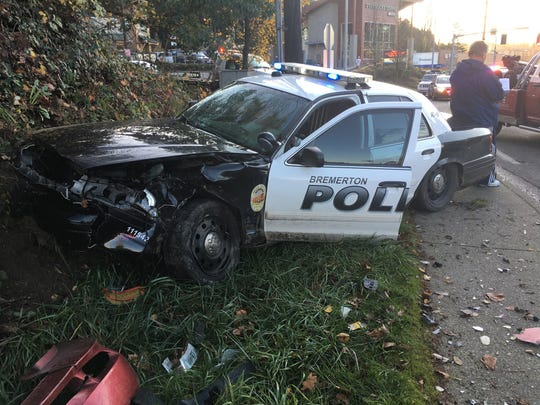 A Bremerton police vehicle en route to a call was hit on Tuesday by a red Mustang that turned in the path of the cruiser. There were no injuries.