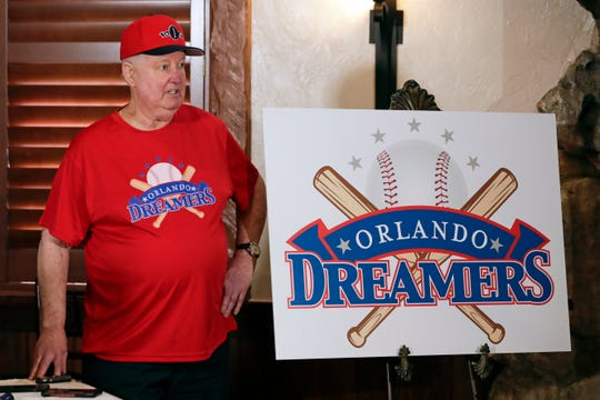 Pat Williams, co-founder of the NBA Orlando Magic basketball team, wears a T-shirt and hat with the logo 'Orlando Dreamers' while speaking at a news conference to announce a campaign to bring a Major League Baseball team to Orlando, Wednesday, Nov. 20, 2019 in Orlando.