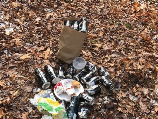 Trash and debris found on Melissa Hoffman and Shawn Smith's land in Huntington, on which they operate a nonprofit called Foundation For A Sustainable Future. At first open to the public, too many instances like these led to their decision to post the land.