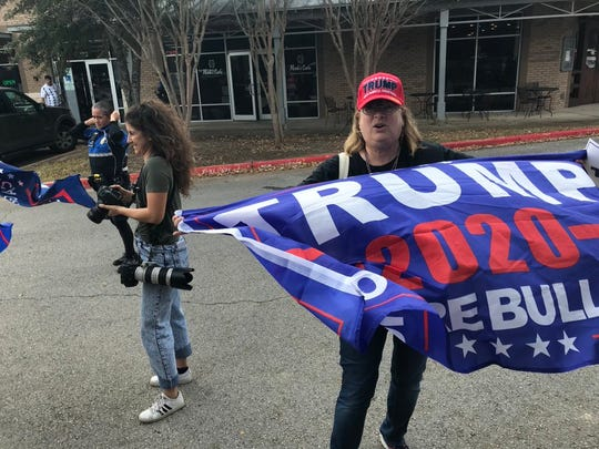 Deb Kast of San Antonio was among the first supporters of President Donald Trump who arrived outside the Apple Flex complex where the president will visit, Nov. 20, 2019.
