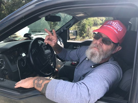 Olin Watson supports President Donald Trump on border and economic policy. He was working near the Apple facility, Nov. 20, 2019.