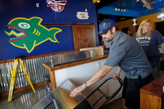 Manager Robert Miller wheels in a margarita machine into the bar area Thursday, Aug. 8, 2013 as he and manager Taryl Farek prepare to set up the machine at the new Fuzzy's Taco Shop on S. Staples Street in Corpus Christi. The new restaurant is scheduled to open Aug. 21 in The Market at Timbergate shopping center. Michael Zamora/Caller-Times