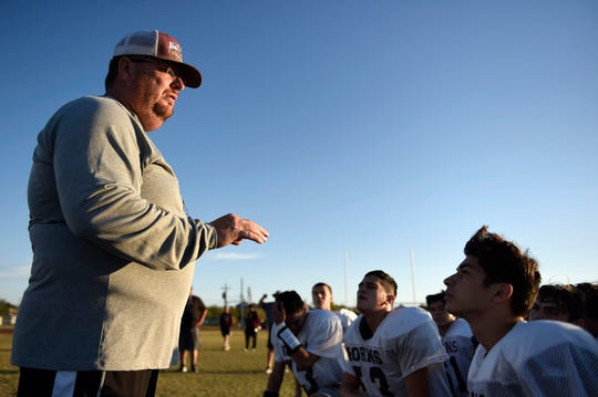 Agua Dulce's head football coach Robert Beard speaks to the team after their football practice, Tuesday, Nov. 19, 2019, in Agua Dulce. Agua Dulce's playoff win on Saturday was the team's first win in the playoffs in 25 years.