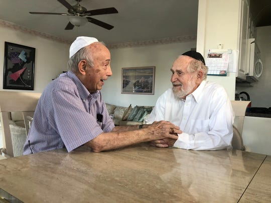 Holocaust survivors and boyhood friends Fred Behrend of Voorhees,  left, and Henry Baum of Southview, Michigan, meet the first time in 80 years while wintering in Florida.