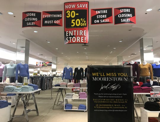 Signs advertise a store-closing sale in December at Lord + Taylor in the Moorestown Mall.
