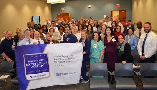 Jennie Mandelbaum, associate director, Quality Solutions, Healthgrades, presented the RWJUH Somerset leadership team with their Patient Safety Excellence Award on Wednesday, Nov. 20.