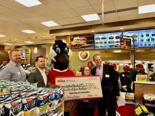 "L to R: Wawa North Plainfield General Manager Stephen Klunder, Area Manager Dan Holland, Wally Goose Mascot, Mary O'Connell, Check Out Hunger Coordinator, Community Food Bank of New Jersey and Jason Read, Director of Store Operations, celebrate the new store opening with a check presentation for the ""Lending a Helping Hoagie Campaign,"" where hoagie proceeds for the first week of sales up to $2,500 is donated to support hunger relief efforts."