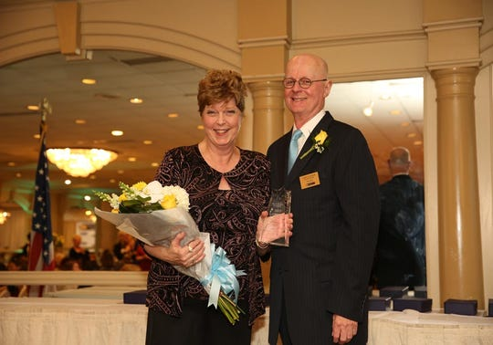 Carol Patterson, 2019 recipient of the New Jersey League for Nursing (NJLN) Nurse Recognition Award, with NJLN President John Lanier.