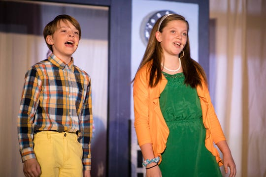 """Western Hills Elementary students Owen Borgstadt and Caci Mulhern rehearse a scene from """"School House Rock! Jr."""" More than 85 students from the West Des Moines school will perform the musical this week."""